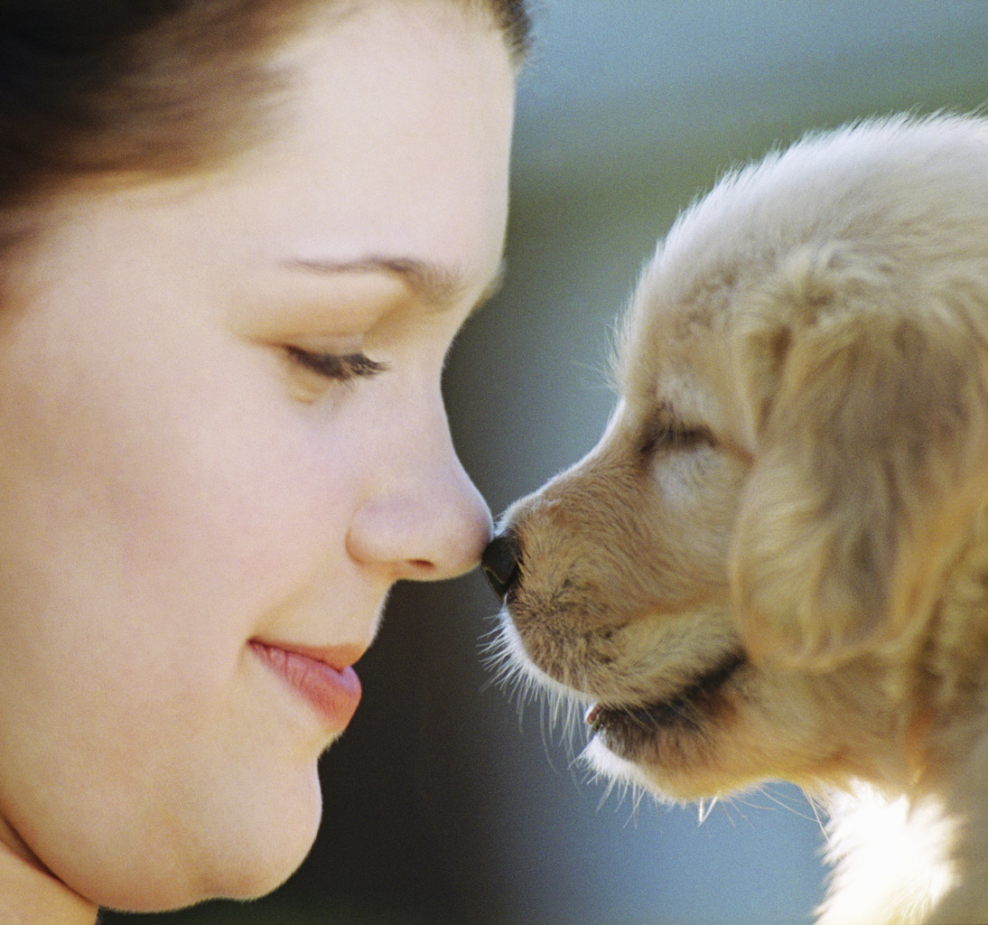 Woman Rubbing Noses with Puppy ca. 2002